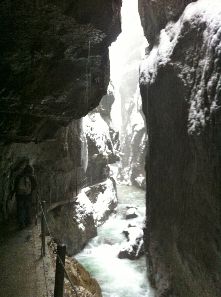 Hiking path takes visitors through caves cut out from the rocks along the gorge.